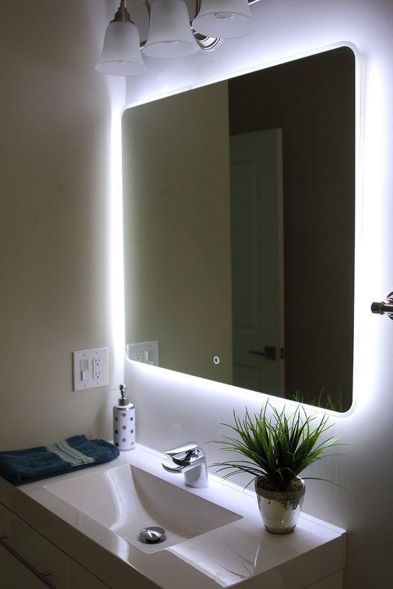 Eclairage derri¨re le miroir de la salle de bain