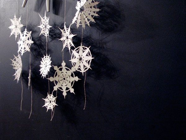 paper snowflakes. i'm thinking white felt would be great, too.