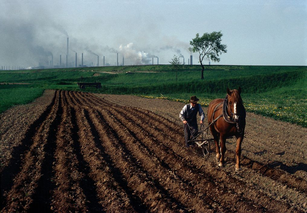 POLAND. 1981. Ploughing near the steel factories of Nowa