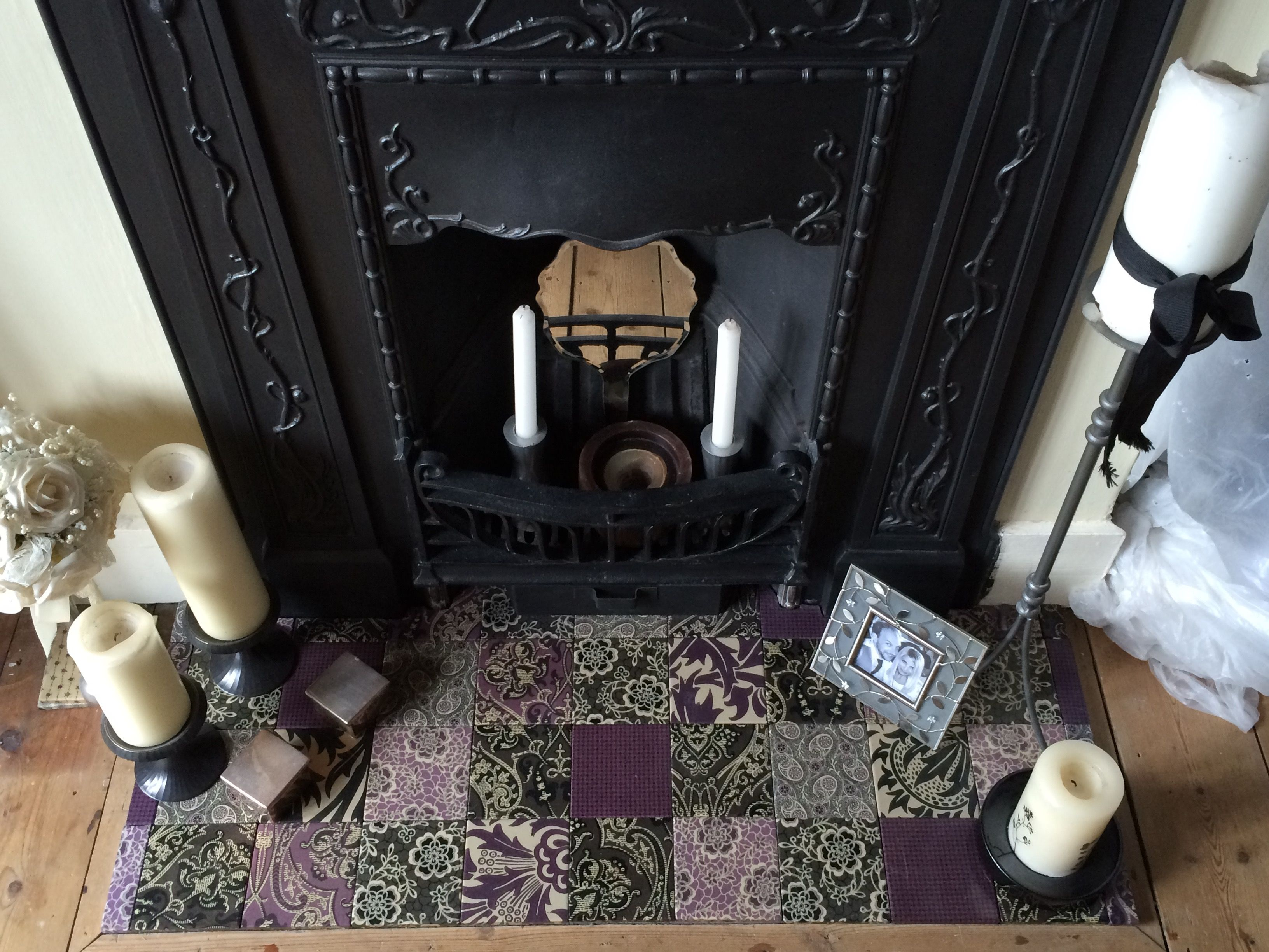 original cast iron bedroom fireplace with homemade decoupage tiles
