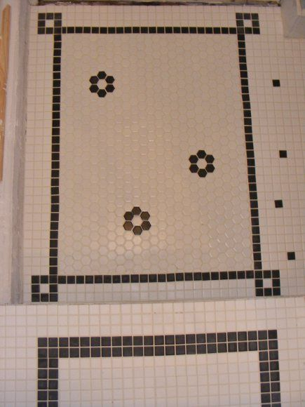 white and brown hexagonal tile bistro-style kitchen floor