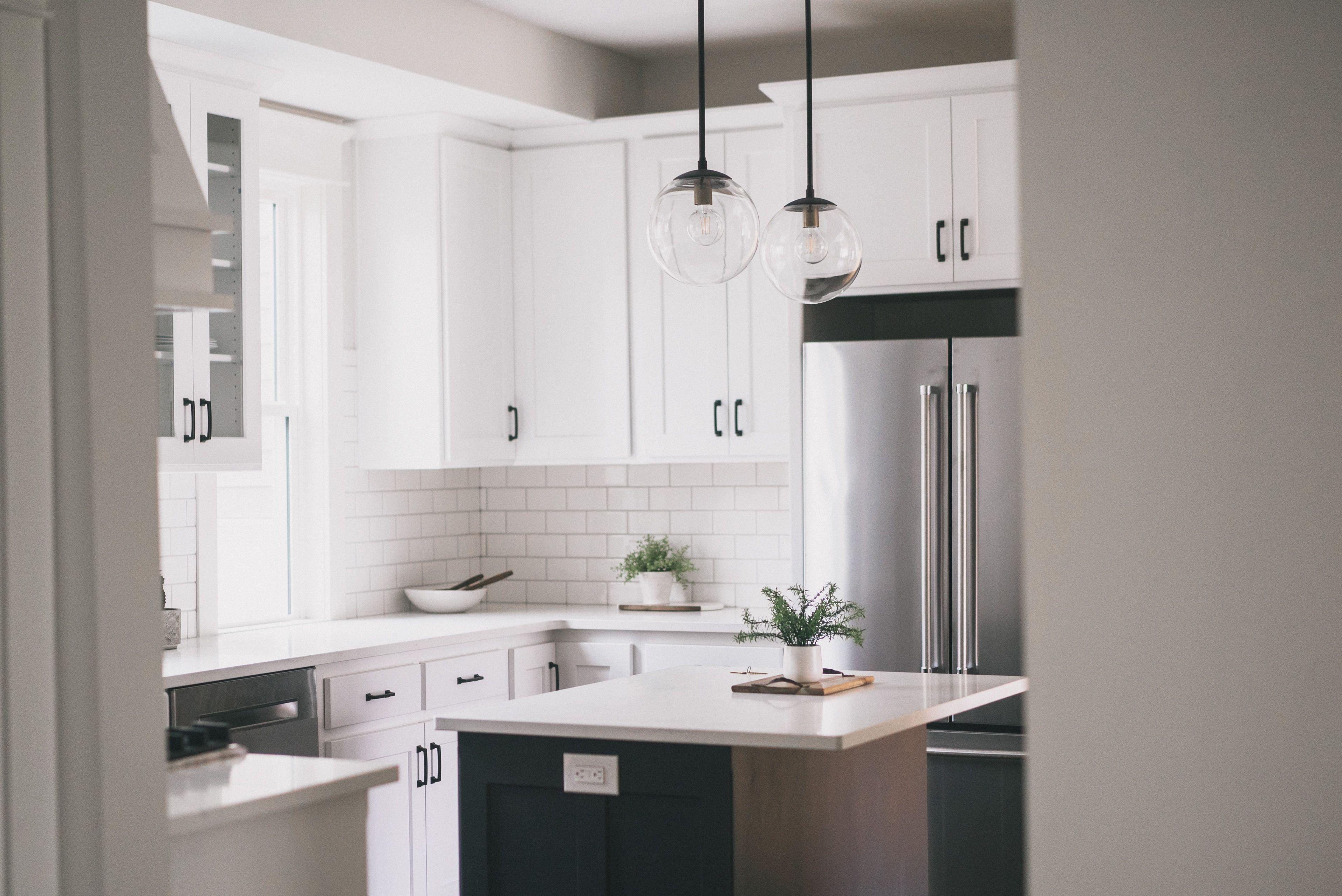 Clean White Kitchen Globe Light Fixtures And White Subway Tile Remodel Flipping Houses White Subway Tile
