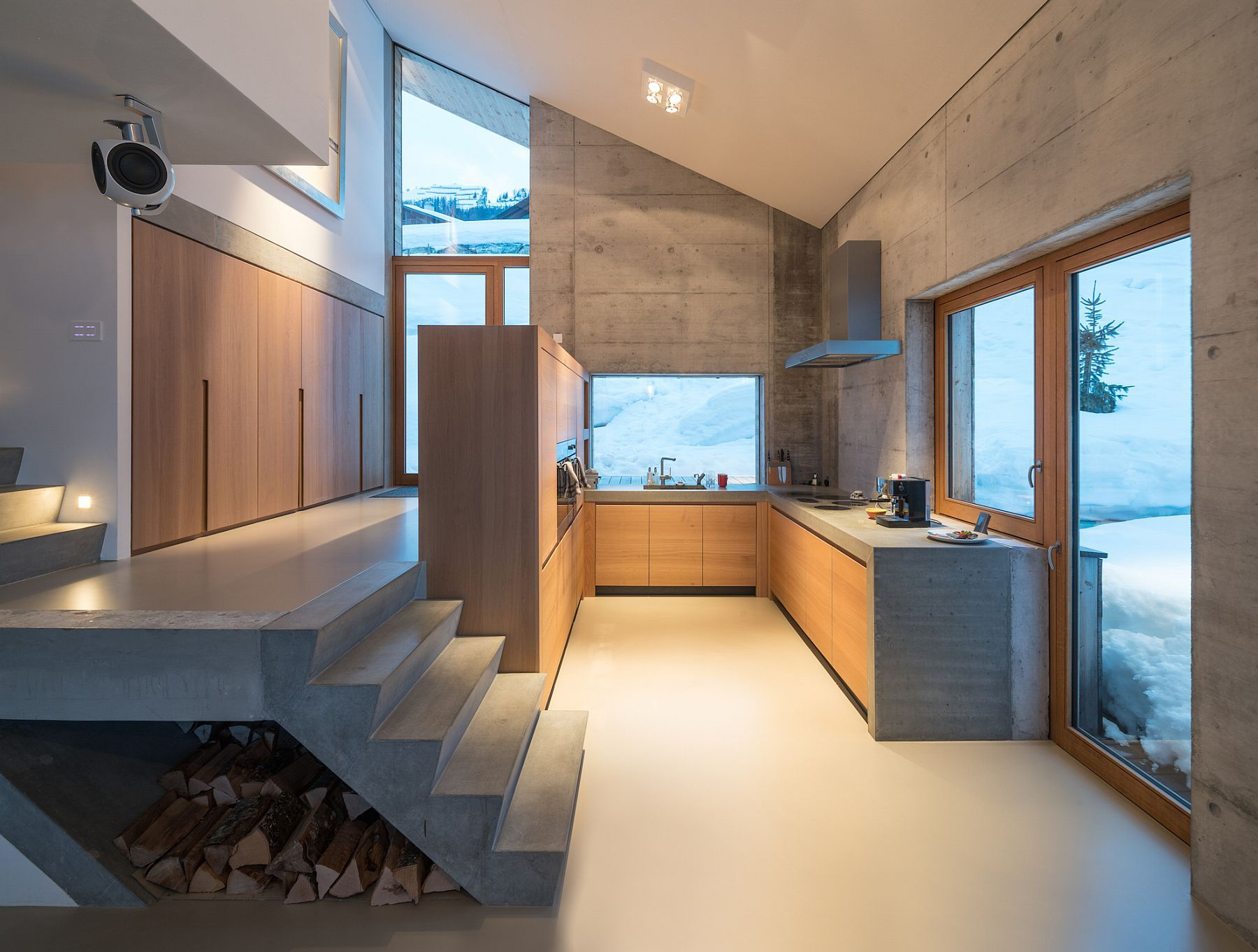 Exposed concrete and wood shape the interior of the contemporary Swiss chalet
