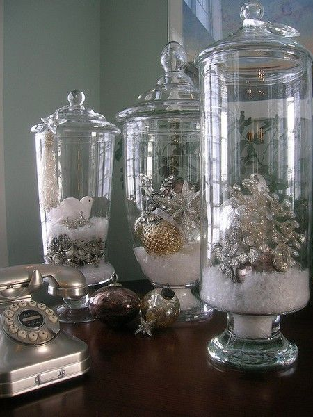 """Christmas decor: hurricane vase with lid, """"snow"""" and ornaments."""