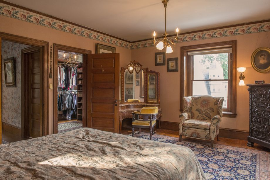 This is a large Master Bedroom with natural wood all