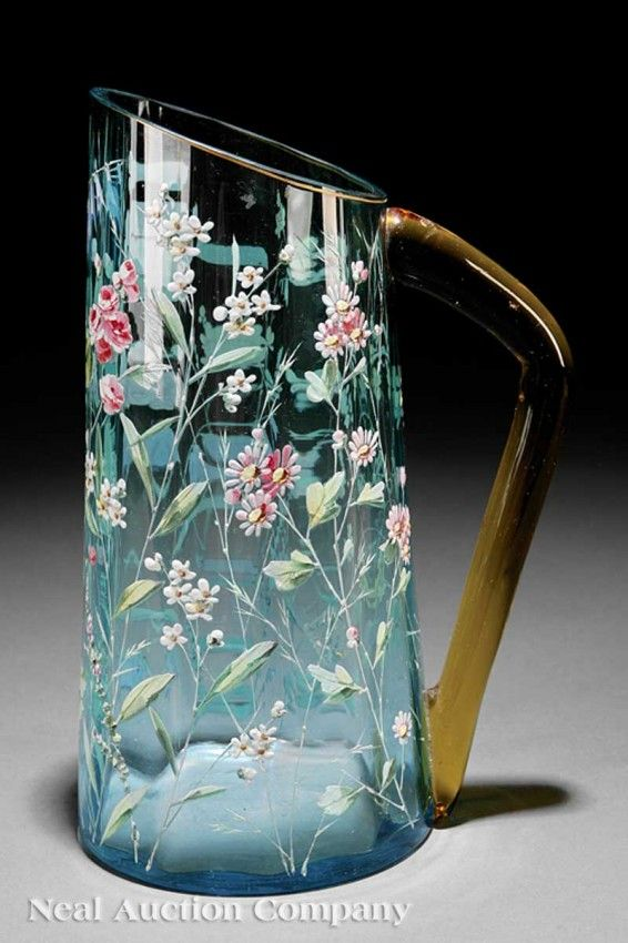 "*MOSER ~ E#nameled Light Blue Glass Pitcher, late 19th/early20th century, tapered cylindrical body w/ extensive applied flora, applied amber handle, signed, H 10 1/4""."