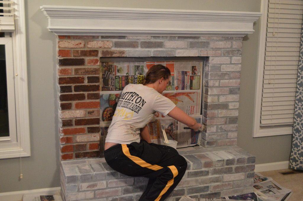 Whitewashed brick and Brick fireplace