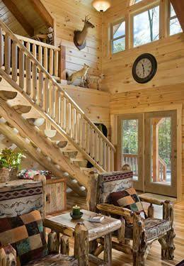 Two Story Foyer Entrance Wood Doors Stairway To Loft Half Log