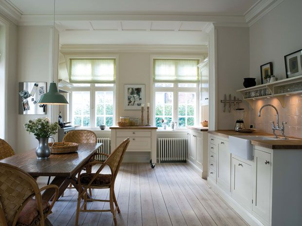 White and wood kitchen, butcher block counters, white apron sink, open shelving
