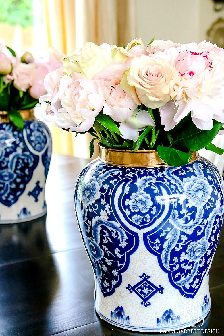blue and white ginger jar with blush and white rose flower
