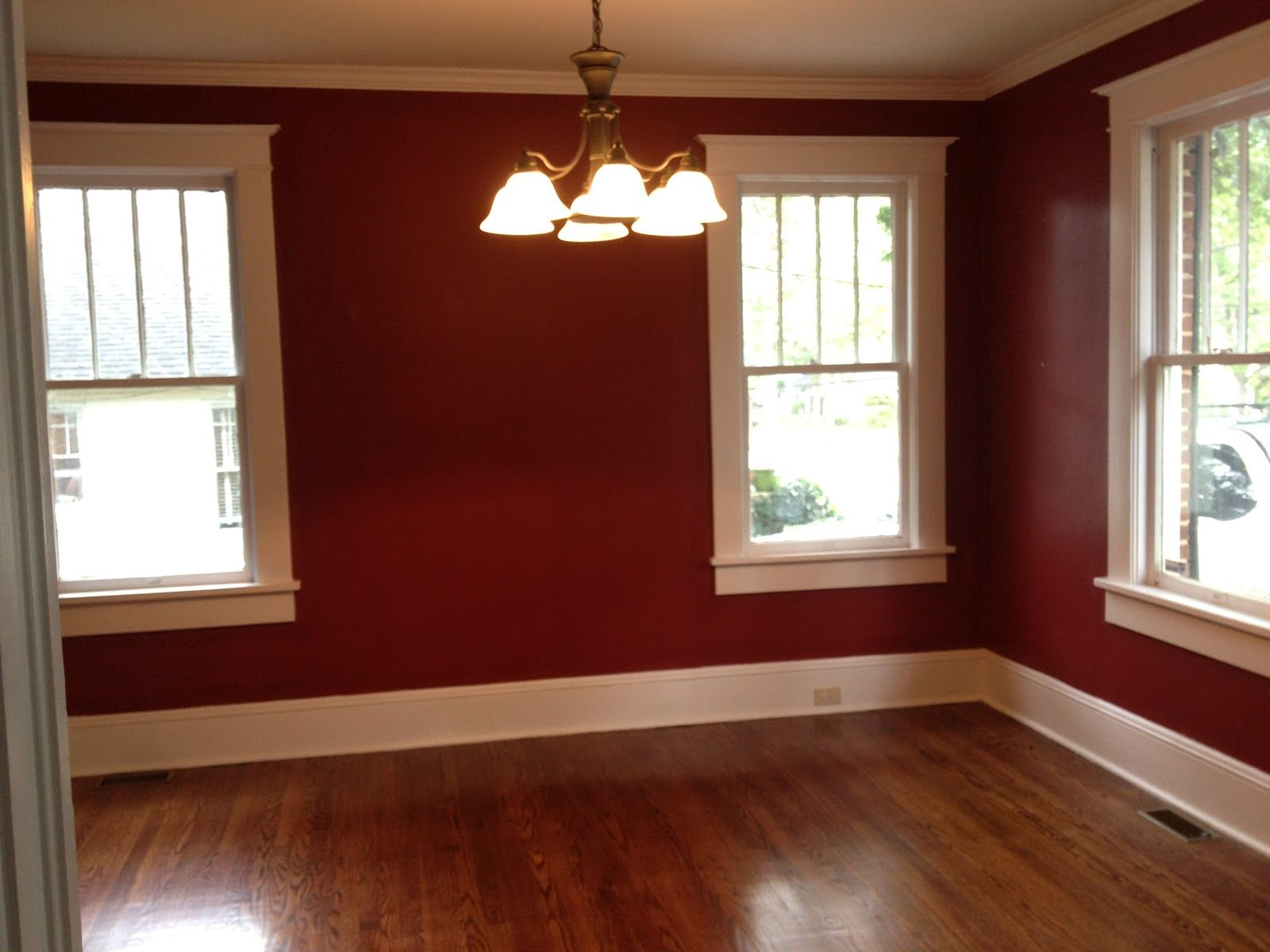 Red walls white trim dark floor houspiration for Red and brown walls