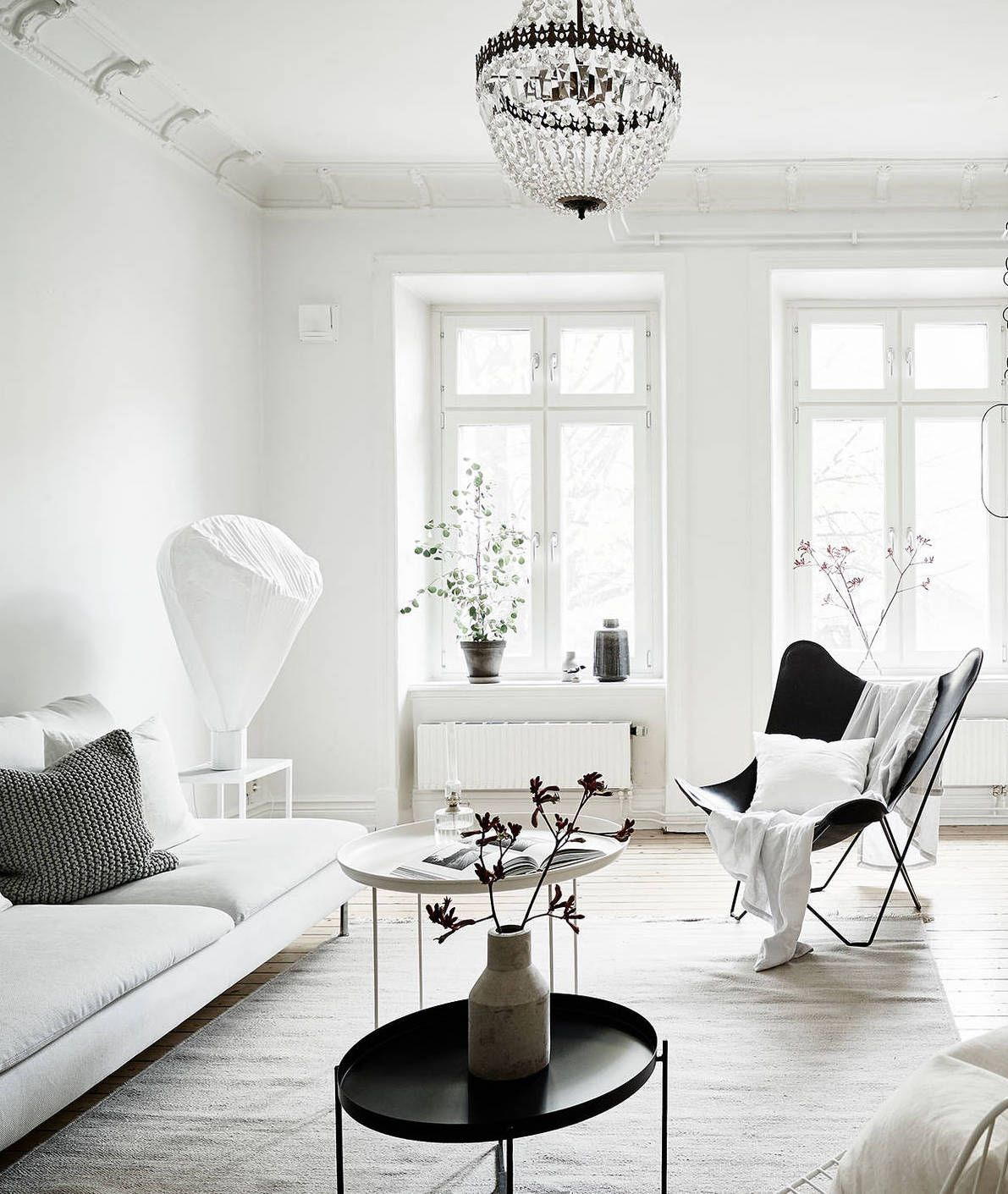 This Bright And White Home Looks All But Cold To Me. The Wooden Details And  Fall Plants Around The House Make This Place Look Very Cozy And Inviting.