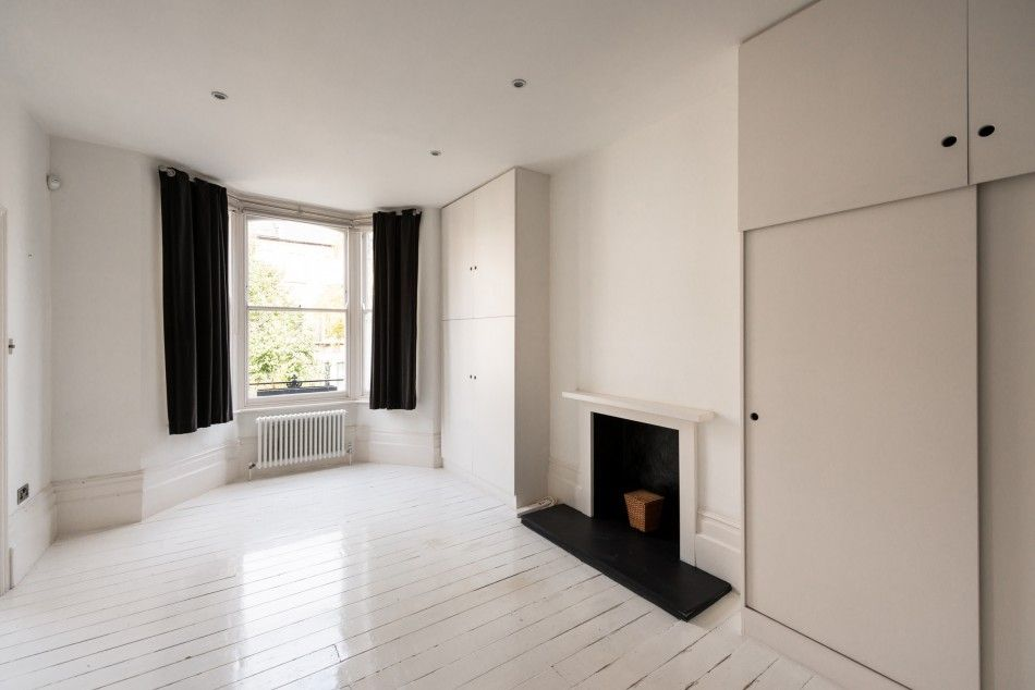 This extraordinary four-bedroom end-of-terrace house offers modern and voluminous living space behind an original Victorian façade. Internal accommodation measures approximately 1,945 sq ft over four storeys, with a number of half levels creating unusual amounts of volume and an engaging layout. Off the entrance hall on the ground floor is a reception room with original […]