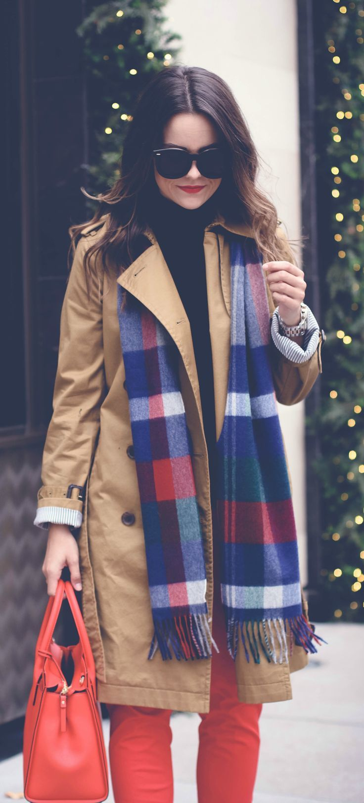 chic winter layers includes a plaid scarf.