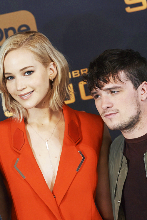 Josh Hutcherson and Jennifer Lawrence attends 'The Hunger Games: Sinsajo - Part 2' photocall at Villa Magna Hotel on November 10, 2015 in Madrid, Spain.