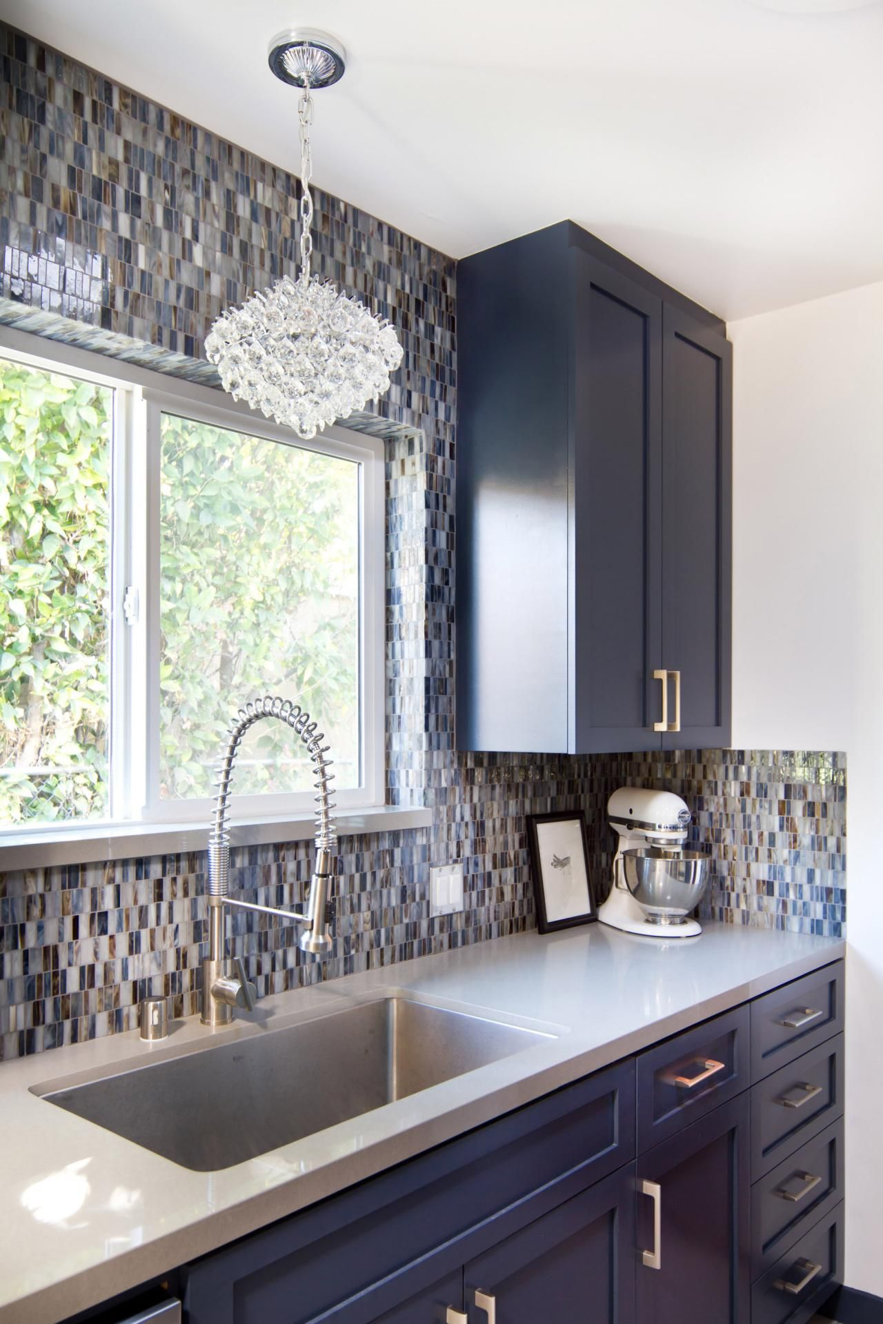A Multi Colored Glass Tile Backsplash Adds Cool Color To This Mid
