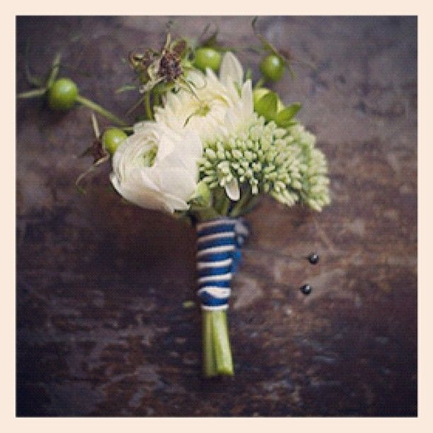 boutonniere.  Very sweet idea, lots of texture, but flowers in blush and yellow.