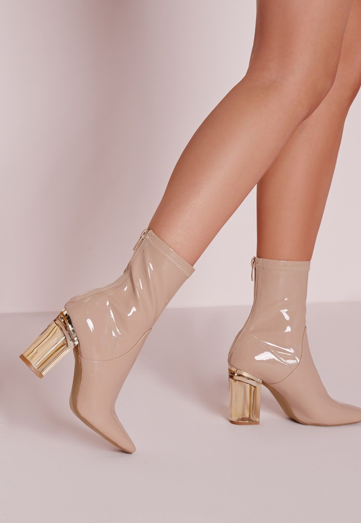 9900aa87edfe Ensure all eyes are on you with this seasons hottest heeled ankle boots!  Featuring a clear gold block heel