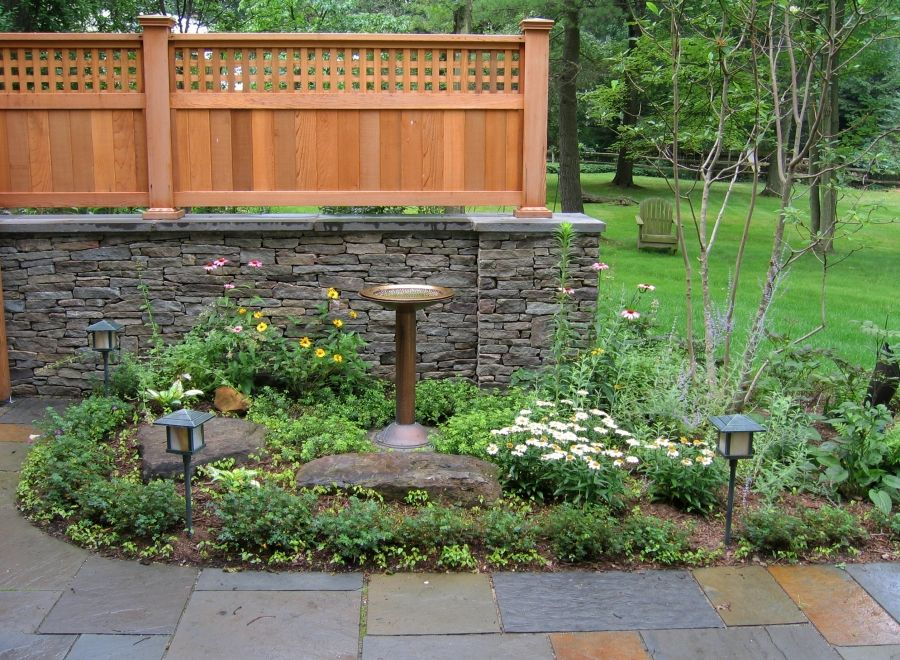 wood and stone fence designs with pbluestone patio
