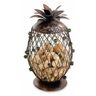 Pineapple Wine Cork Cage The Pineapple Wine Cork Cage looks great as a center piece at weddings or displayed in your kitchen or bar area for the collection of wine corks. This metal cage is in the shape of a pineapple. This clever design has green glass balls swirled in the metal for a little bling. Cherish your wine memories by saving wine corks. Show them off in this innovative way instead of letting them pile up in a drawer. Cork cages feature m...
