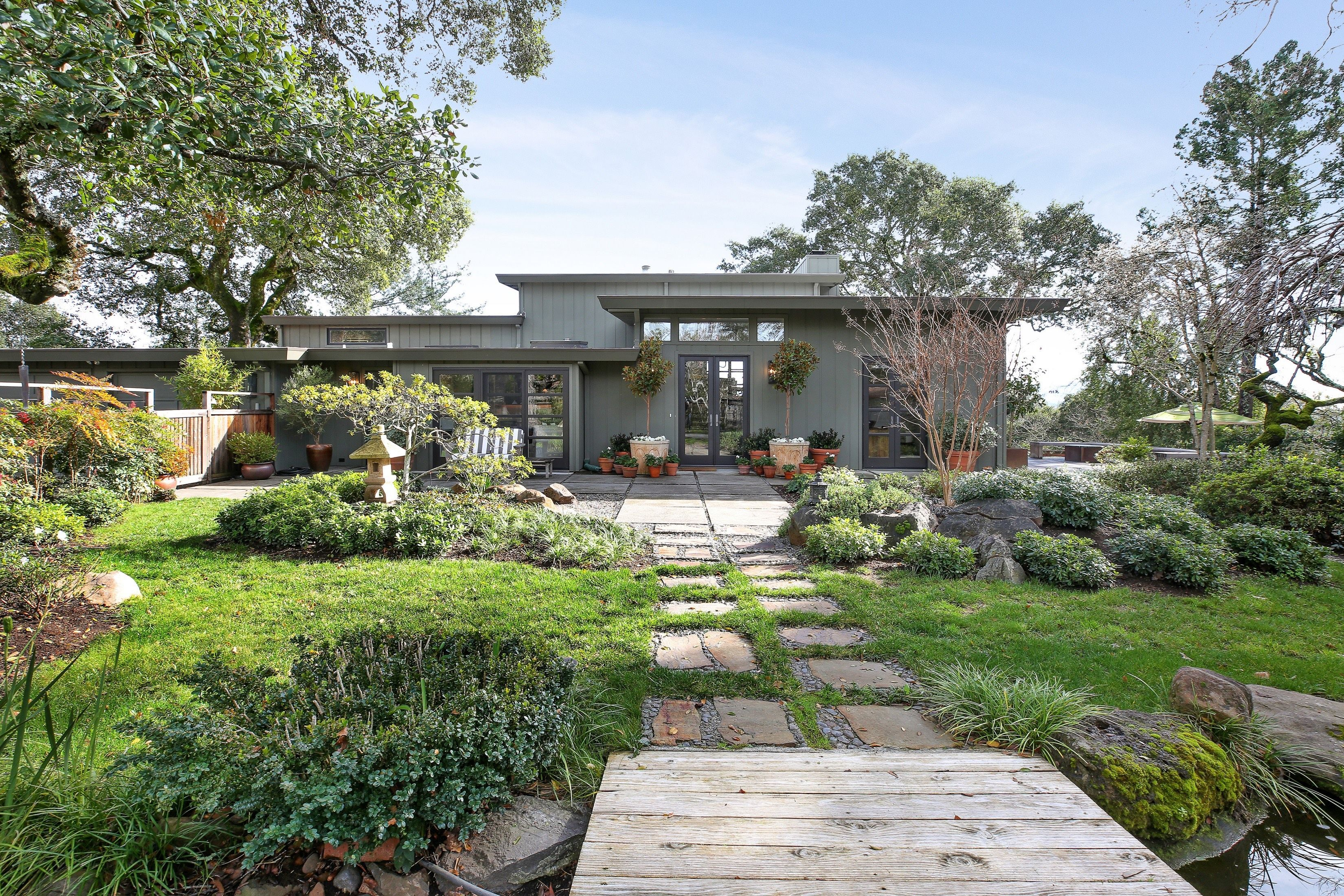 Beautiful and spacious both inside and out this midcentury modern