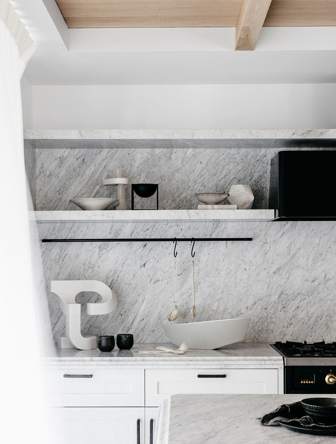 white Carrera marble kitchen backsplash