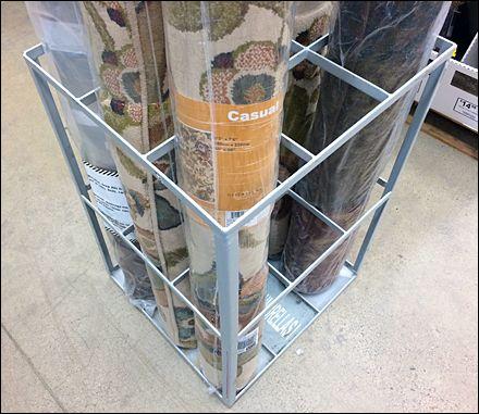 Freestanding Divided Carpet Rack Fixtures Close Up Carpet Showroom Interior Design Store Design