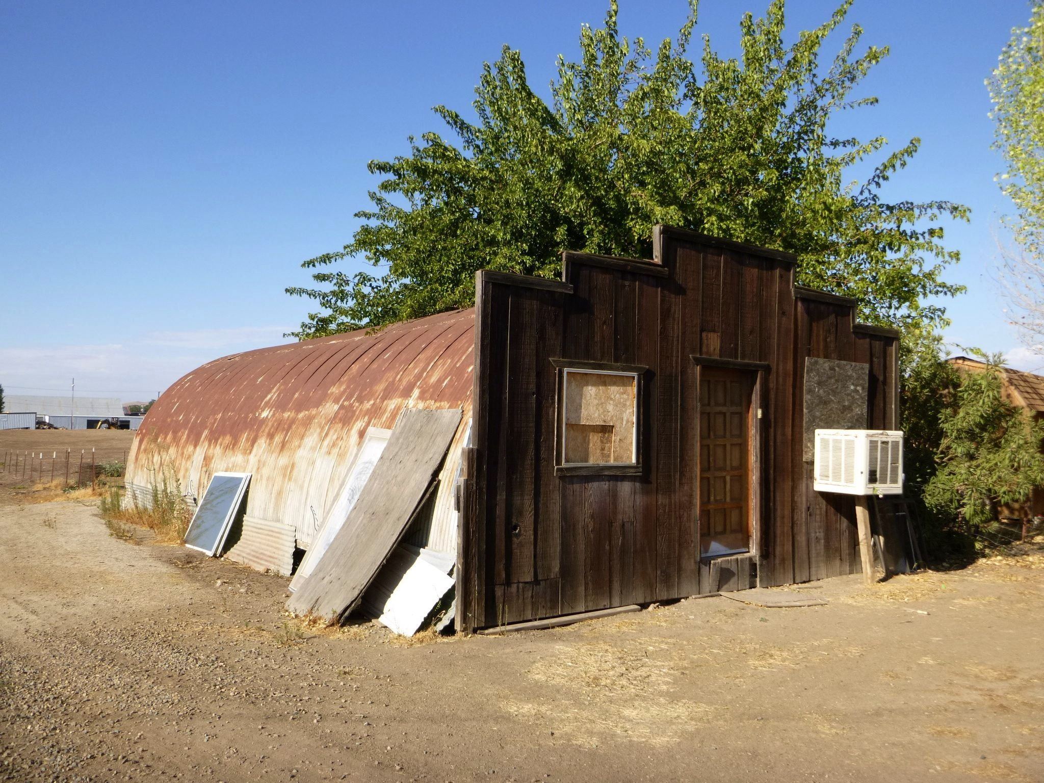 Quonset hut with wooden store front addition former for Quonset hut