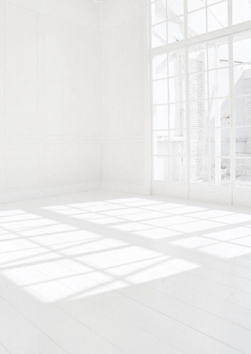White room with high ceilings and stunning windows. Such a calming space to look at.