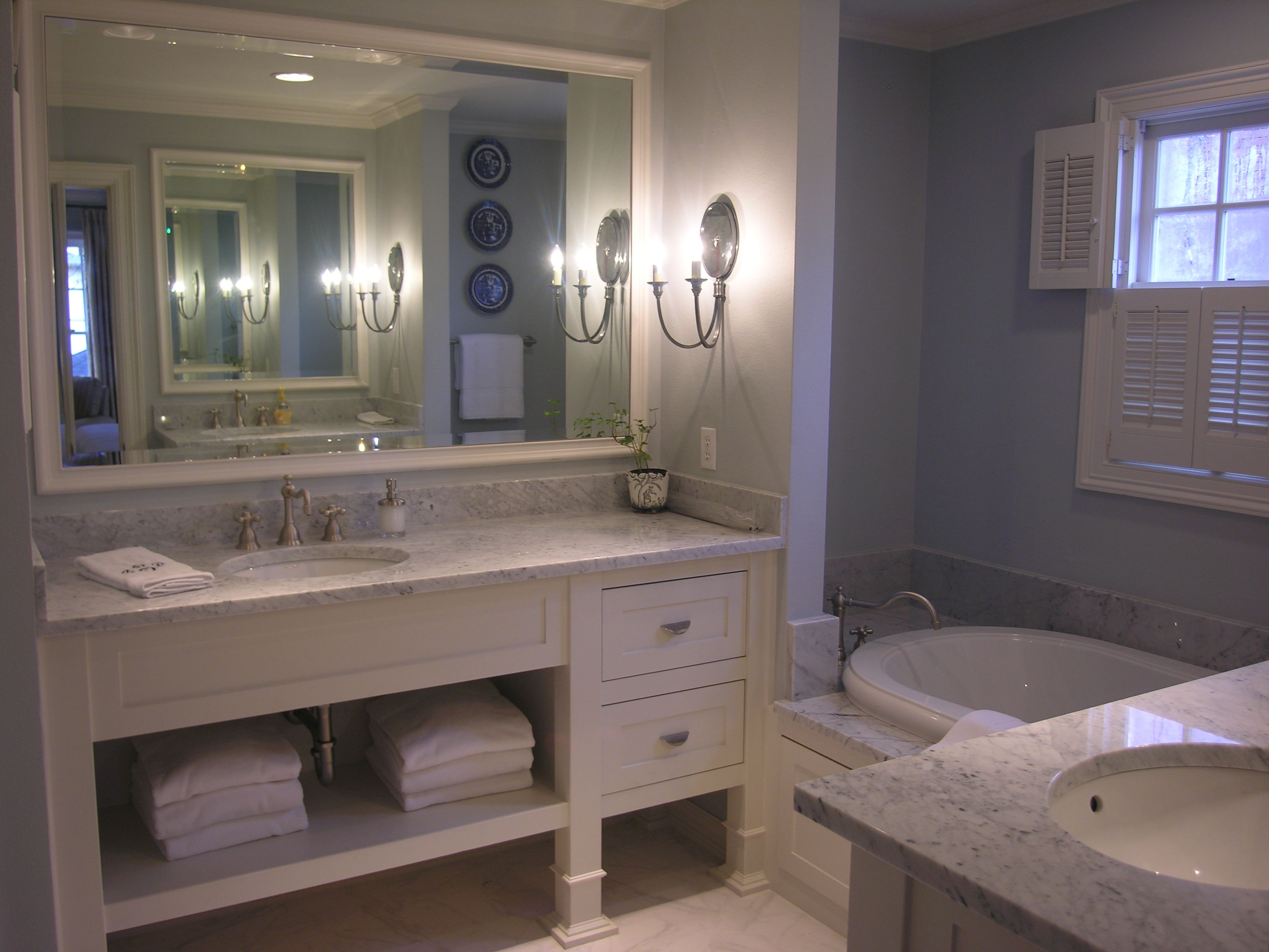 Small Master Bath Made To Look Larger With Ear Walls