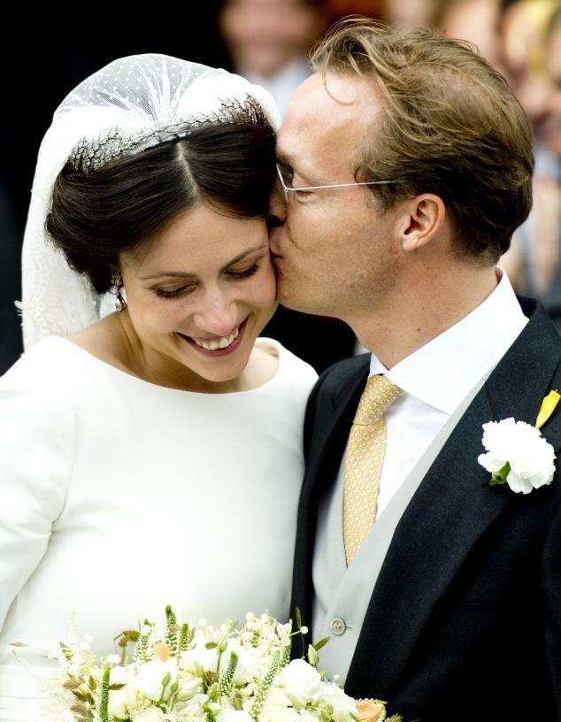 Newlywed...The Prince Jaime Bourbon-Parma lovingly kisses his new wife Viktoria Cservenyak on the cheek