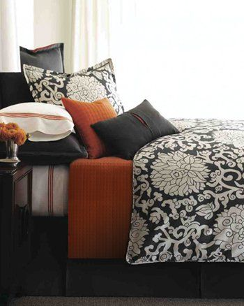 i love the black and white bedroom with a splash of color
