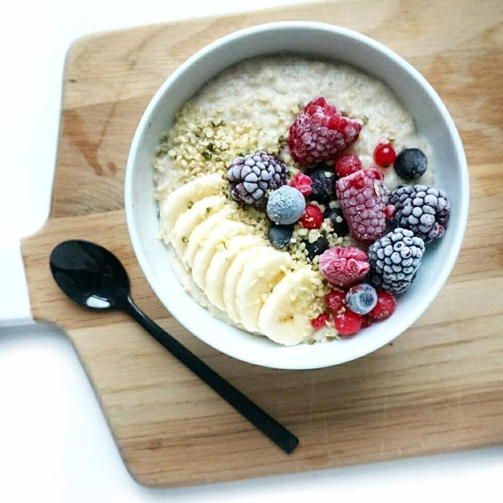 Creamy microwave oatmeal with frozen berries banana and