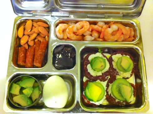 """pepperoni stick, almonds, avocado chunks, egg, summer sausage """"sandwiches"""" (w/ goat cheese, cucumber, avocado), cooked shrimp, and bits of chocolate"""