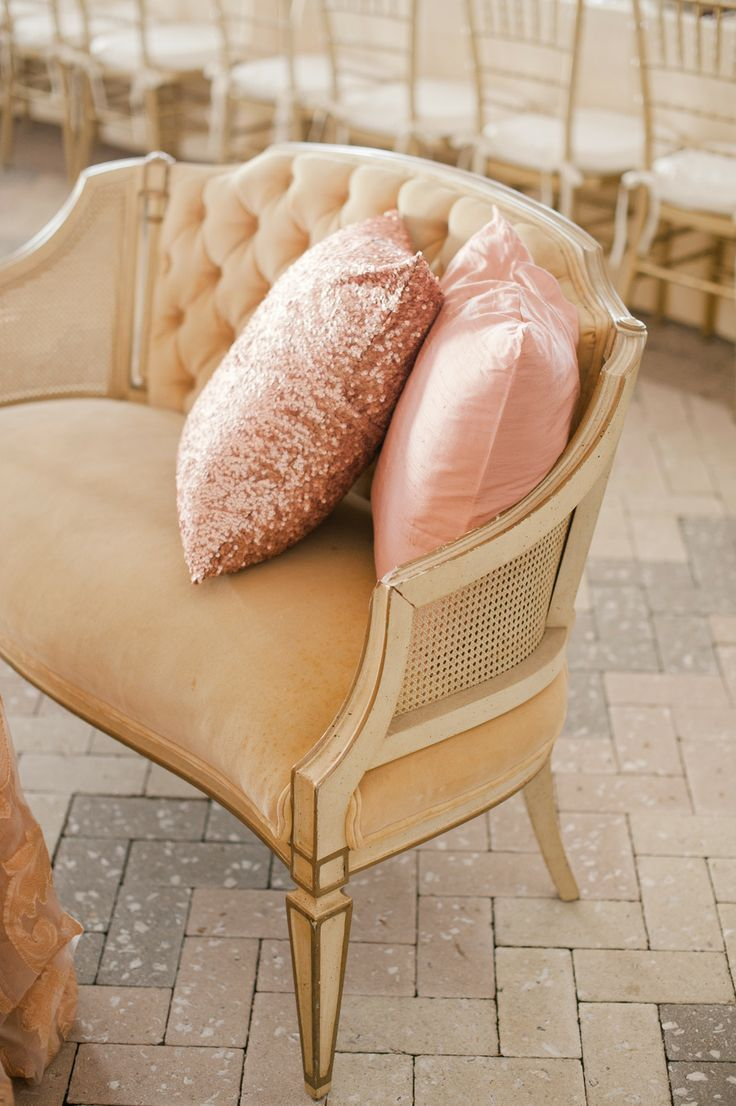 Caned settee in champagne with pink pillows