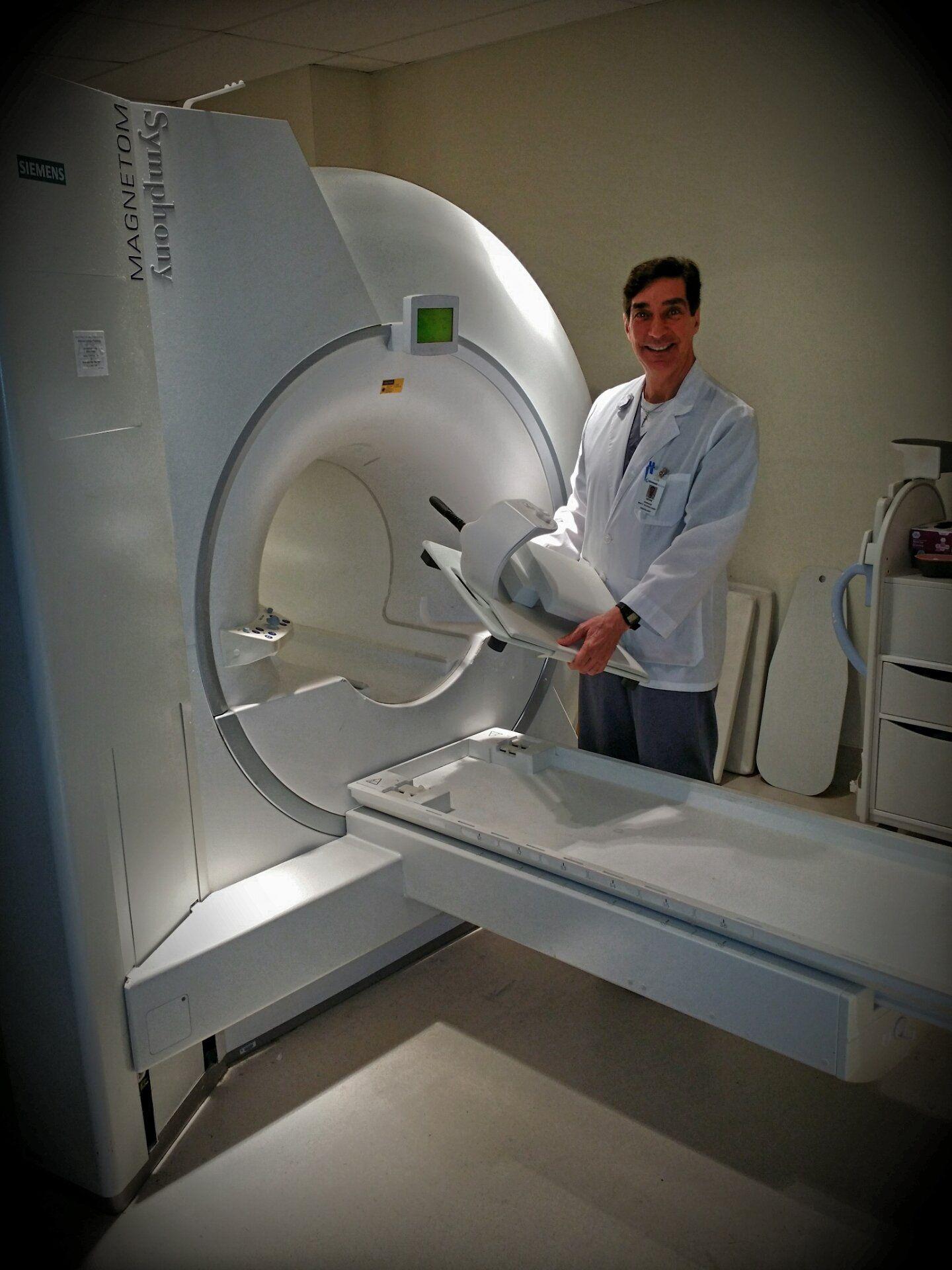 Mri technologist preparing the machine for the next
