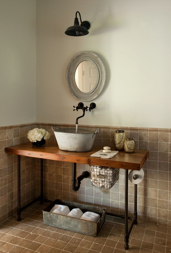 A Galvanized Bathroom Sink On A Wooden Countertop With Black Pipe - Bathroom vanity pipes