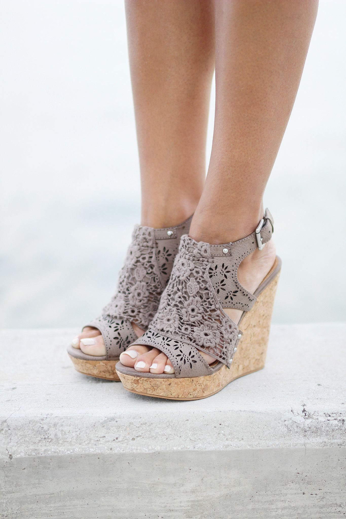 """Meet your new bestie, Candace! These wedges are simply gorgeous, with a laser-cut pattern and feminine lace overlay, all stacked on top of a 4 1/2"""" wedge with 1 1/4"""" platform. The both of you are sure"""