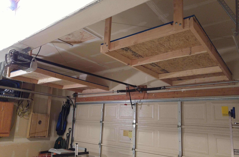 Above Garage Door Storage Project Diy Finished Garage Storage Shelves Garage Door Design Garage Hanging Storage
