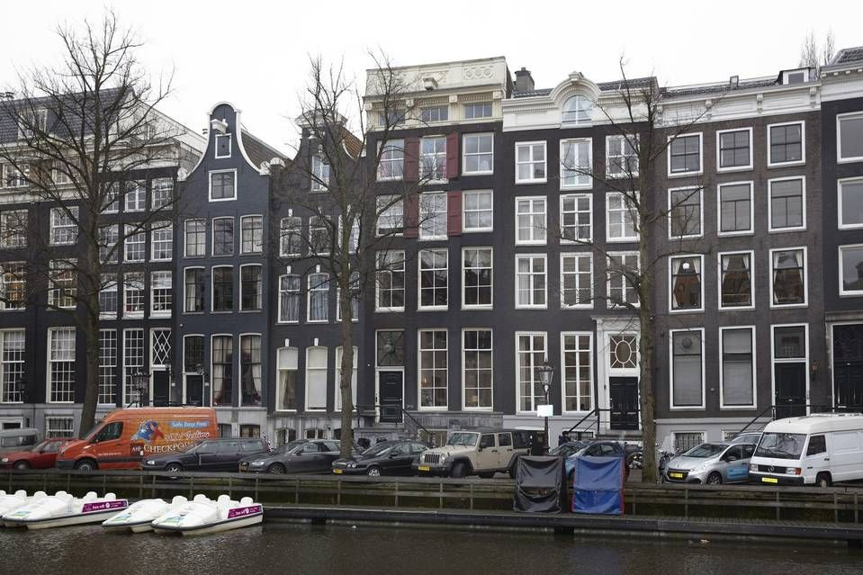 One of the rare canal-house estates that have remained intact over the centuries has hit the market. The property (the tall building at center with the flat ornamental top) on the Keizersgracht canal has an asking price of $8.4 million. It has a main mansion, a carriage house and a secluded garden in-between.