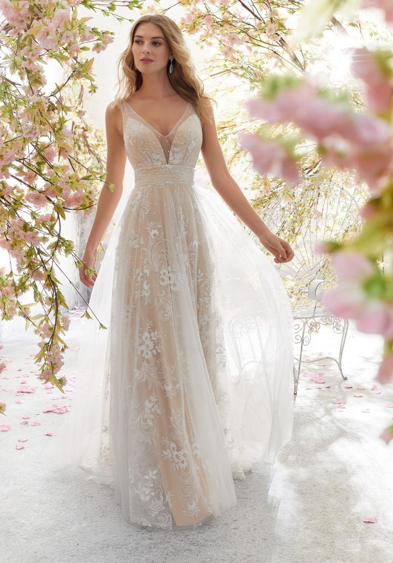 Sweet yet sophisticated this slim aline wedding dress features