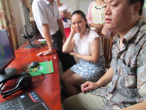 lex Wang with the teacher of the blind at Du_an Special Education School