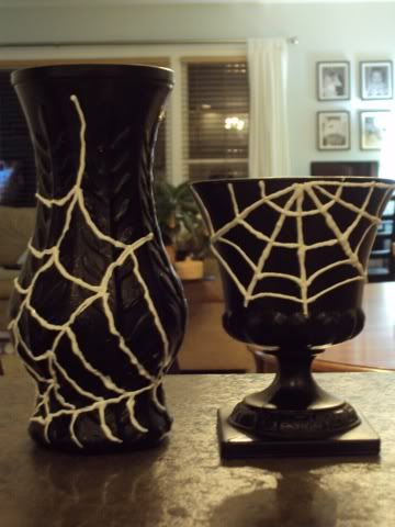 Rummage Sale Vase to Halloween Decor. I feel like so much more could be done with this idea than just spider webs. Like painting Halloween color designs in stripes, and dots, or even just painting the vases to look old and creepy. :D