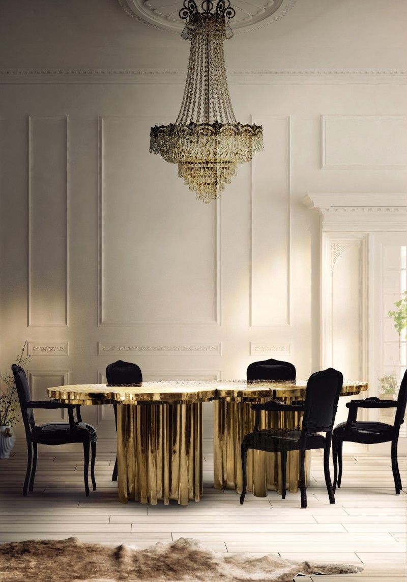 Representing the essence of empowerment sophistication mystics and enticement the fortuna gold dining table features a one of a kind design