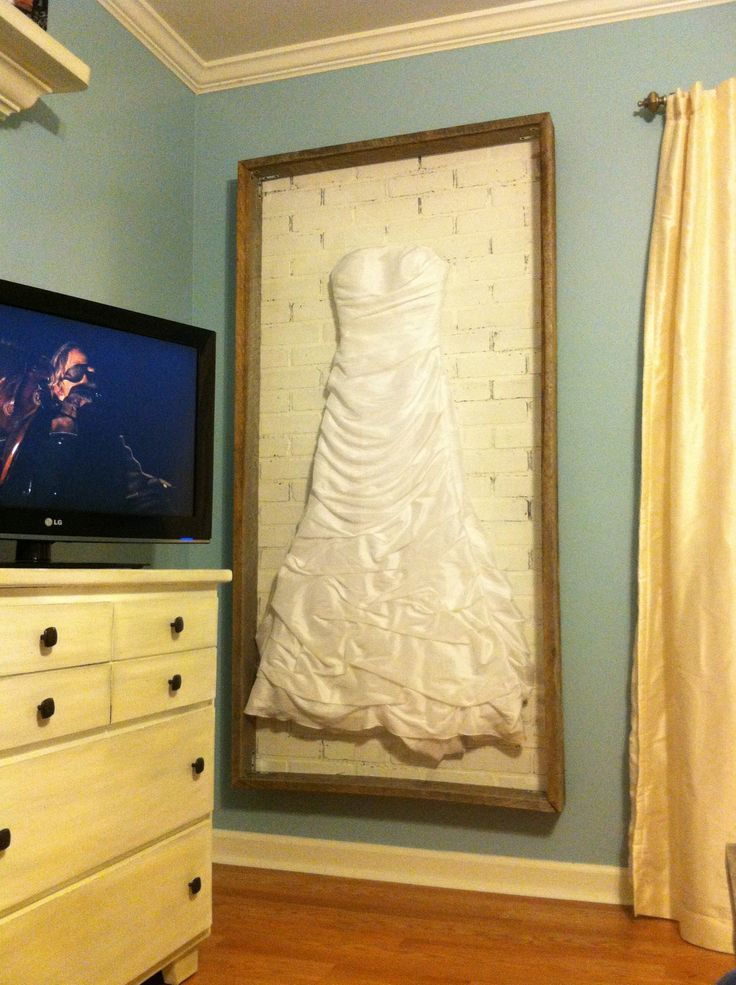wedding dress display but closed in with glass