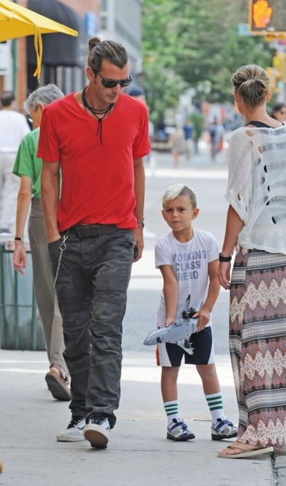 """Kingston Rossdale is wearing a shirt that says """"Working Class Hero."""" What an oxymoron. Try something a little more accurate next time, like """"Poorly Dressed Half-Hair"""" or """"Help Me With My Sock Situation."""""""