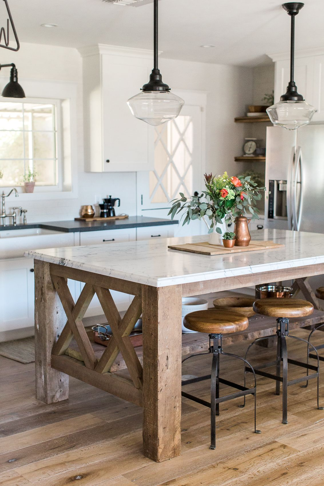 custom kitchen island built from barnwood with marble countertop