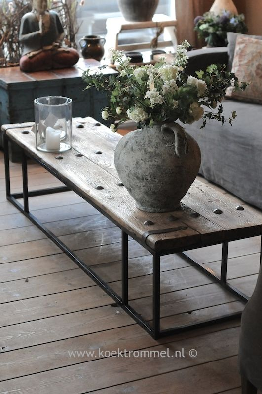 Photo of coffee table from old door with iron fittings