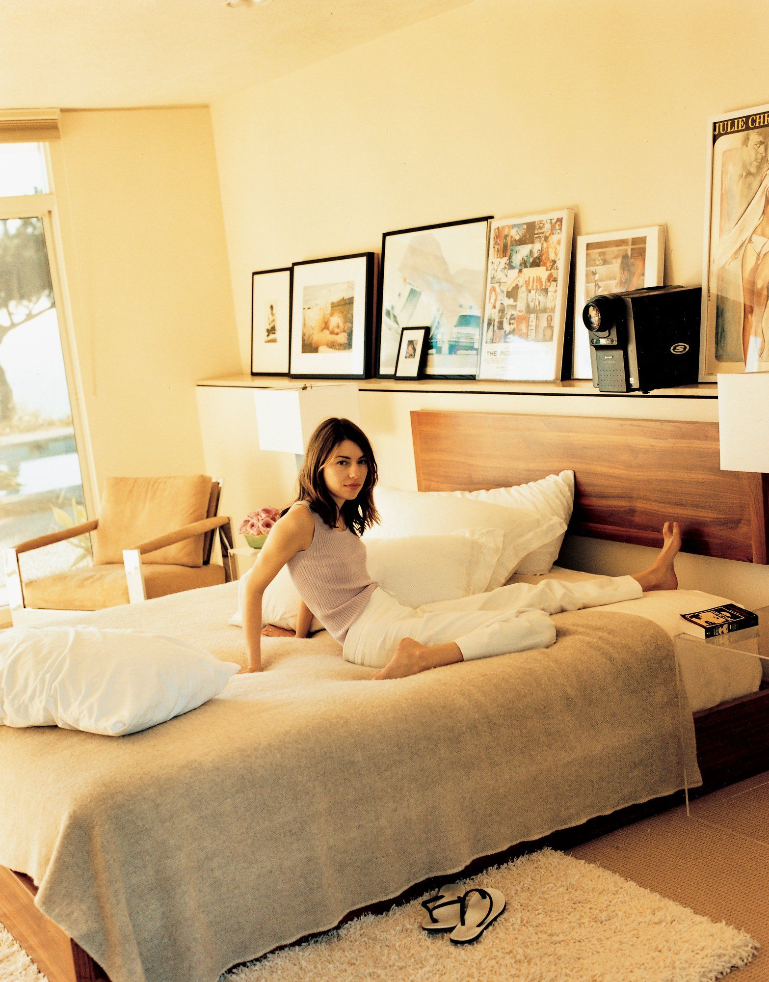 Sofia Coppola In Her Mid Century Modern Bedroom Complete With Rug And Vintage Fashion Photography