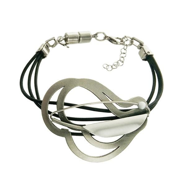 Triple leather bracelet with curvy silver centerpiece a matte silver half petal and a pearlescent bead. Created in the Montreal studio of Christophe Poly.